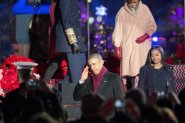 President Barack Obama returns a salute from members of the military as he walks off stage with his daughter Sasha and his mother-in-law Marian Robinson during the National Christmas Tree Lighting ceremony at the Ellipse in Washington, Thursday, Dec. 3, 2015. (AP Photo/Pablo Martinez Monsivais)