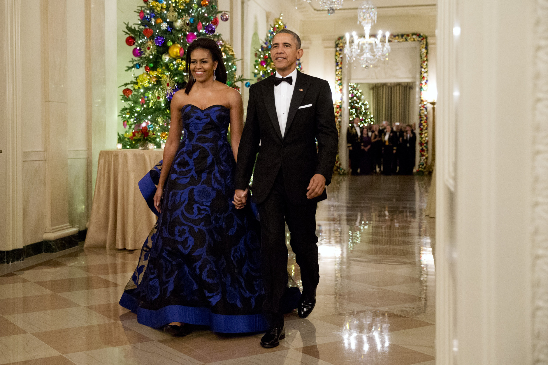 President Barack Obama and first lady Michelle Obama arrive at the 2015 Kennedy Center Honors reception in the East Room of the White House in Washington, Sunday, Dec. 6, 2015. (AP Photo/Jacquelyn Martin)