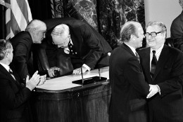 U.S. President Gerald Ford congratulates Vice President Nelson A. Rockefeller, right, after he was sworn-in on the floor of the Senate in Washington, D.C., Thursday night, Dec. 19, 1974.  Rockefeller is the 41st vice president of the United States.  (AP Photo)