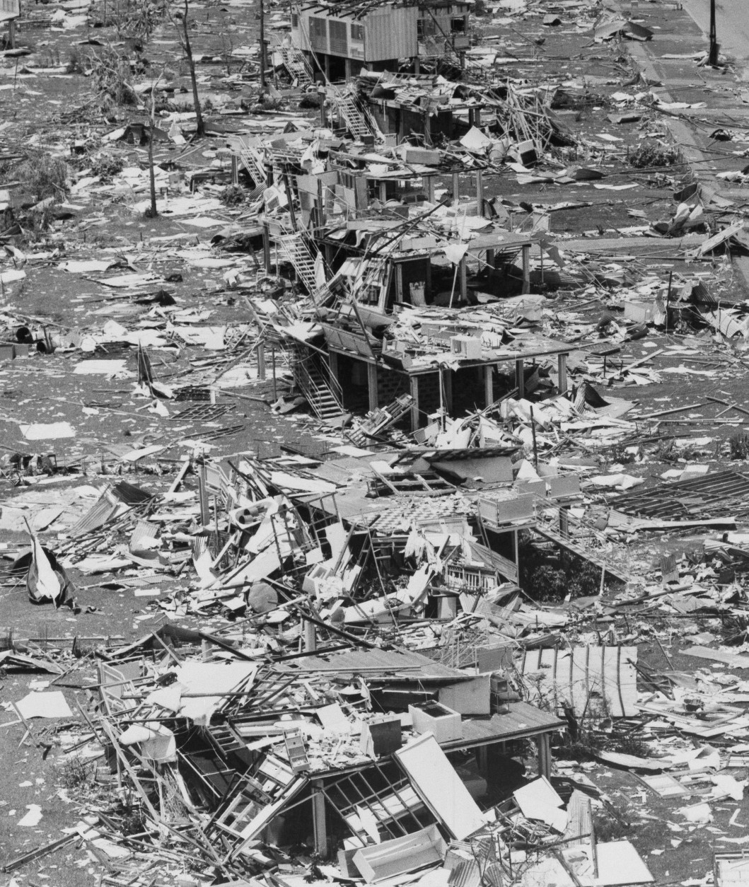 A photograph June 26,1975 of Darwin after Cyclone Tracy hit last Christmas Day Dec. 25, 1974, shows a row of stilt houses smashed and surrounded by rubble. Darwin is Australia's northernmost city, with a population at the time of the cyclone of 46,000. Nearly two thirds of the houses in town were wrecked in the storm, which also killed 49 people. (AP Photo/Jim Bourdier)