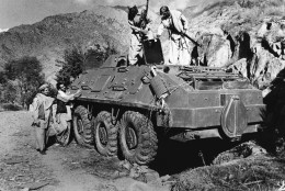 Rebel Muslim fighters inspect a Soviet tank captured in fighting with the Kabul government forces on September near Asmar, Afghanistan on Thursday, Dec. 27, 1979. The Kabul government of Hafizaullah Amin was overthrown by former Deputy Prime Minister Babrak Karmal. (AP Photo/Steve McCurry)