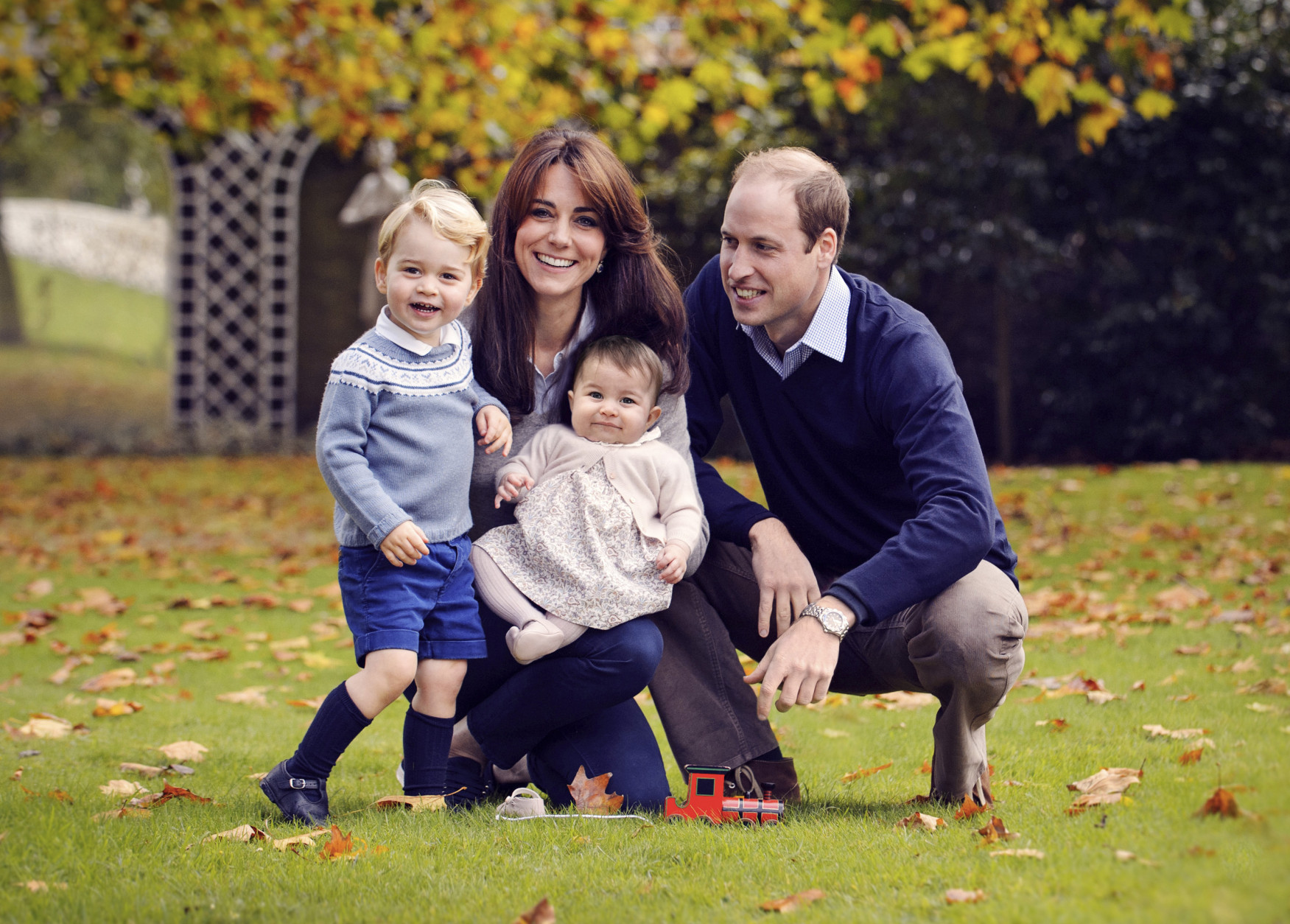 This photo released by Kensington Palace on Friday Dec. 18, 2015 shows The Duke and Duchess of Cambridge with their two children, Prince George and Princess Charlotte, in a photograph taken late October 2015 at Kensington Palace in London. (Chris Jelf via AP) MANDATORY CREDIT