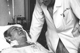 """Artificial heart recipiant Barney B. Clark, left, smiles at his surgeon, Dr. William DeVries, in Salt Lake City, in this Dec. 3, 1982 photo. Clark, who lived 112 days with the Jarvik-7 heart after the landmark surgery, had little expectation of longtime survival. """"He had faced his mortality,"""" said his widow UnaLoy Clark-Ferrar. """"He knew he was going to die. He knew he had to be in that position (for doctors) to consider him. He saw it as a real opportunity for him to contribute something to medical science. That was the reason he did it."""" (AP Photo)"""