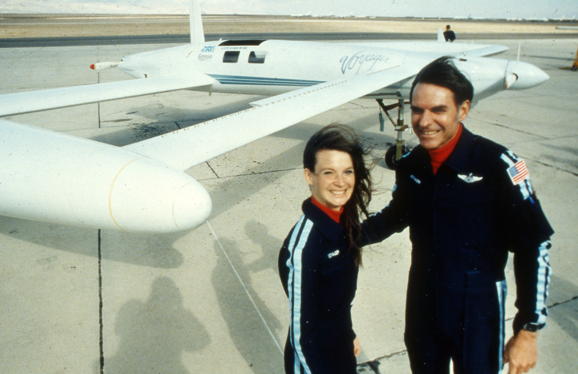 Co-pilots Dick Rutan and Jeana Yeager, left, (no relationship to test pilot Chuck Yeager), will attempt to circumnavigate the globe without refuelling in an experimental aircraft called Voyager. Photo was taken after a test flight over the Mojave Desert December 19, 1985. The aircraft is made of plastic and graphite fiber composite and able to carry five-times its own weight in fuel, was designed by Rutan's brother, Burt, and is so economical that it can complete the 25 000 mile (40 250 km) flight along the equator in about 12 days with fuel to spare. (AP Photo/Doug Pizac)