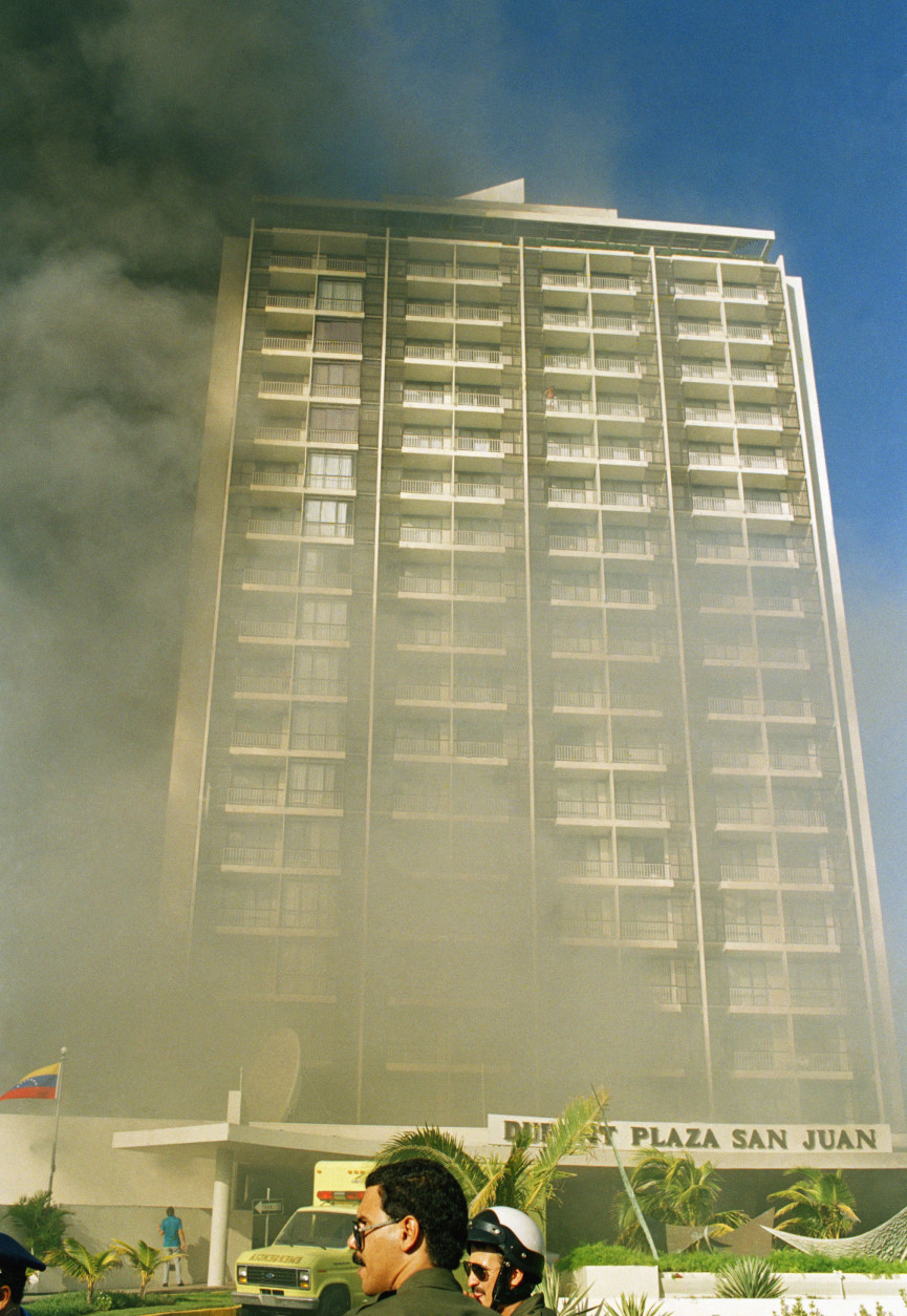 A fire breaks out at the Dupont Plaza Hotel in San Juan, Puerto Rico on Dec. 31, 1986. (AP Photo)