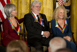 2015 Kennedy Center Honors honorees from left, actress and singer Rita Moreno, filmmaker George Lucas, and singer-songwriter Carole King, react as President Barack Obama speaks about Lucas during the 2015 Kennedy Center Honors reception in the East Room of the White House in Washington, Sunday, Dec. 6, 2015. (AP Photo/Jacquelyn Martin)