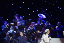 Actress Bellamy Young performs on stage with the United States Coast Guard Band during the National Christmas Tree Lighting ceremony at the Ellipse in Washington, Thursday, Dec. 3, 2015. (AP Photo/Pablo Martinez Monsivais)