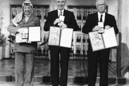 PLO leader Yasser Arafat, left, Israeli Prime Minister Yitzhak Rabin, centre, and Israeli Foreign Minister Shimon Peres pose with their medals and diplomas, after receiving the 1994 Nobel Peace Prize in Oslo's City Hall, Dec. 10, 1994. The three men received the prize for their efforts towards peace in the Middle East. (AP Photo)
