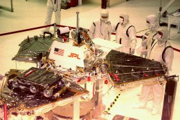 ADVANCE FOR SUNDAY, JUNE 29--FILE--Workers from NASA's Jet Propulsion Labs look over the  Mars Pathfinder Oct. 1, 1996 at Kennedy Space Center in Florida. The spacecraft will land on Mars July 4, 1997, and the rover Sojourner lower left with wheels, will explore the surface of the planet.   (AP Photo/Florida Today,Mike Brown)