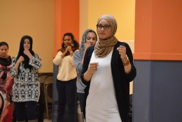 Sameerah Siddiqui stands with hands in place ready to practice her punch. (WTOP/Omama Altaleb)