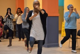 Siddiqui practices her front kick with fists out. (WTOP/Omama Altaleb)