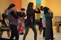 Muslim women get ready to practice their punches. (WTOP/Omama Altaleb)
