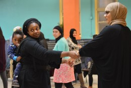 Siddiqui practices the triangle maneuver with a partner (or two). (WTOP/Omama Altaleb)