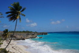 This January 2015 photo shows Bottom Bay in Barbados. The Caribbean island is relatively easy on the wallet, with easy-to-use public vans to beaches around the island, plus dining options like Oistins Fish Fry, an outdoor bazaar of restaurant shacks serving heaping plates of food. (AP Photo/Kavitha Surana)