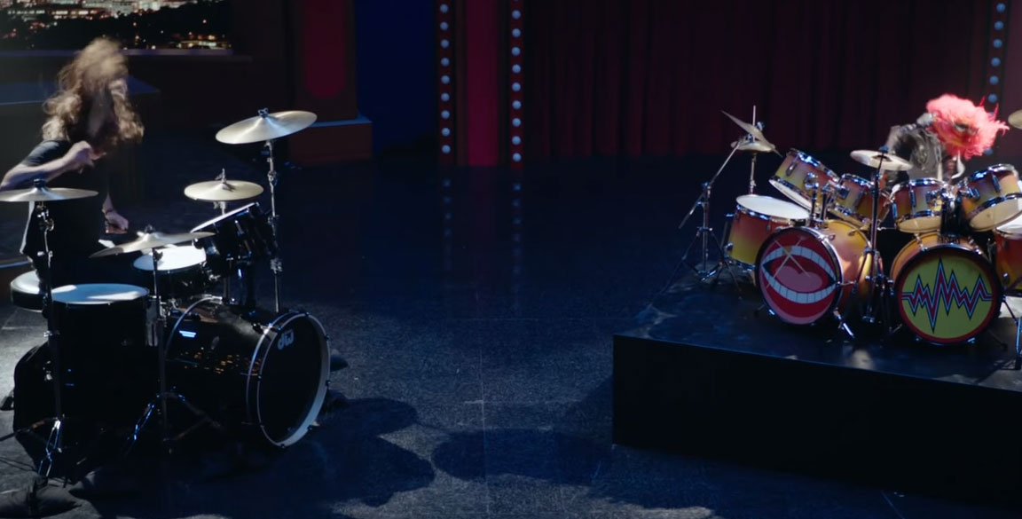 Foo Fighters' Grohl engages Muppets' Animal in drum-off (Video)