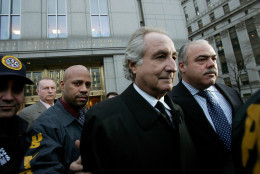 NEW YORK - JANUARY 5:  Bernard Madoff (L) walks out from Federal Court after a bail hearing in Manhattan January 5, 2009 in New York City. Madoff is accused of running a $50 billion Ponzi scheme through his investment company. Madoff is free on bail and hasn�t formally responded to the charges or entered a plea.  (Photo by Hiroko Masuike/Getty Images)