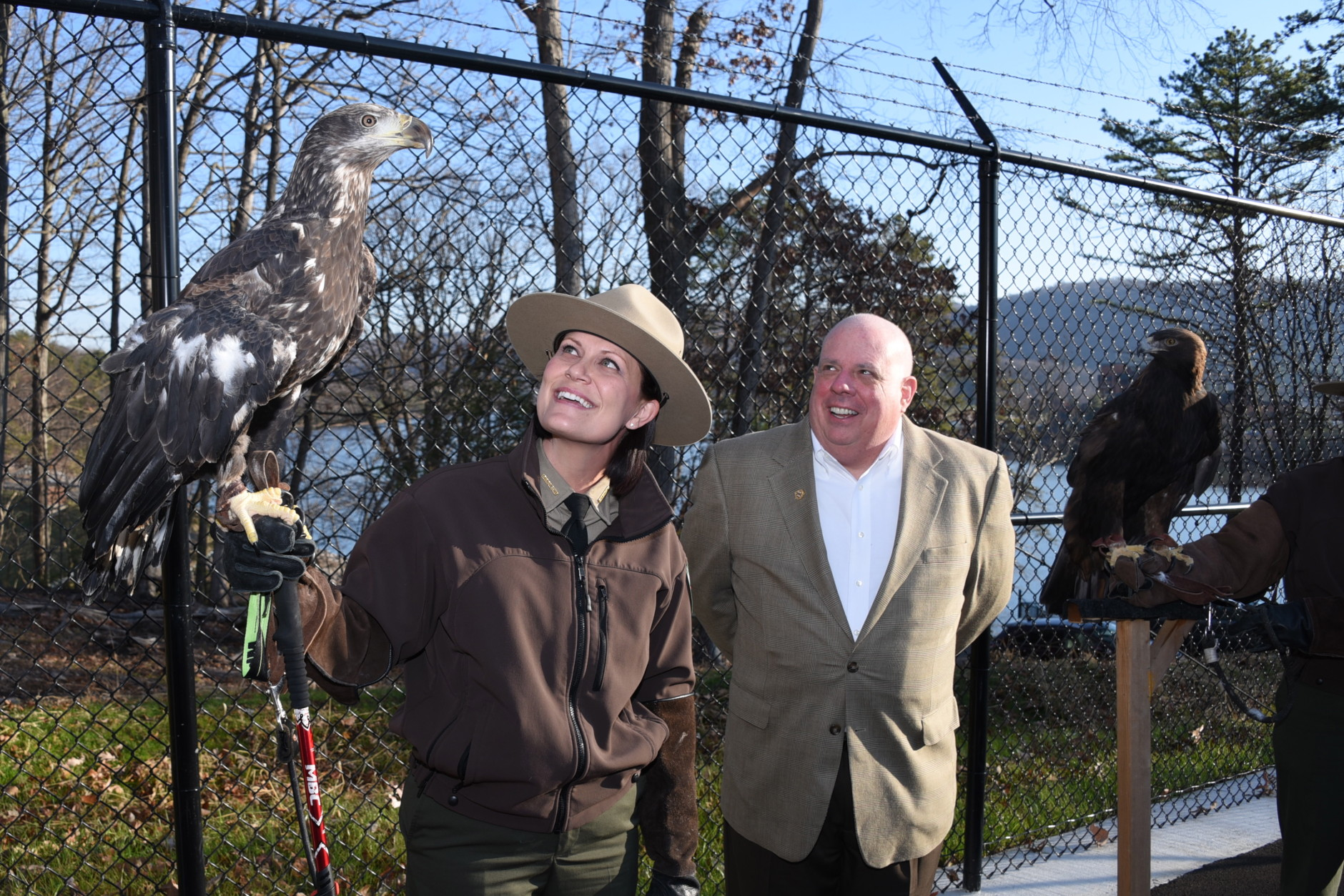 Ranger Sarah Milbourne, Mo the eagle, and Governor Hogan. (Courtesy Joe Andrucyk/Office of Gov. Hogan)