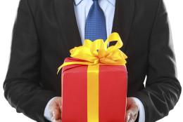 Businessman present gift box