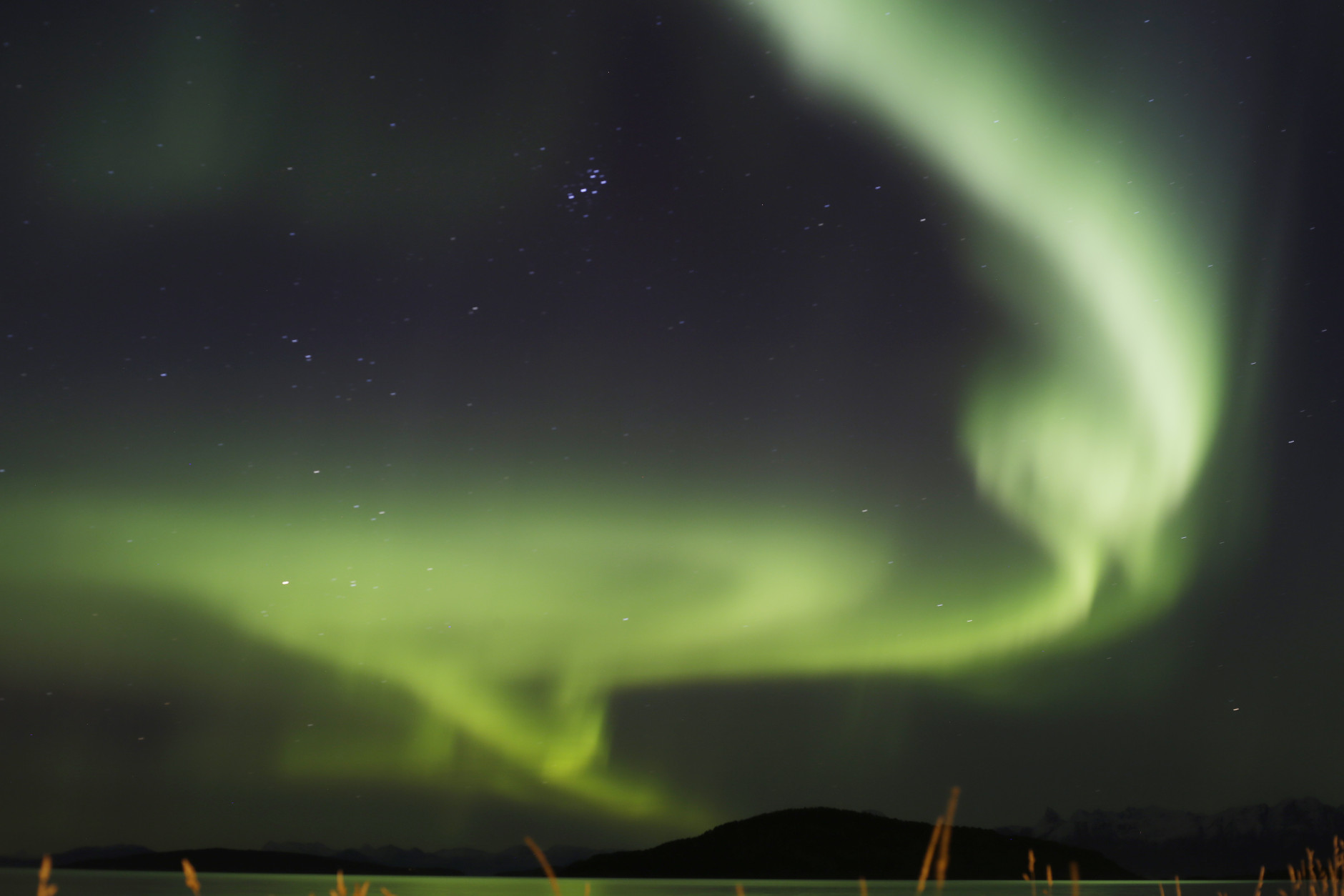 "FILE - This Oct. 5, 2015 file photo shows the aurora borealis, or Northern Lights, over the Norwegian town of Harstad. Tourism to destinations like Norway, Iceland and Alaska has been growing in popularity in the coldest, darkest months, and Norway in particular has seen more tourists because of the movie ""Frozen."" (AP Photo/Gregorio Borgia, File)"