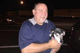 Dennis Christner says his family's trip from Poland, Maine, to Sarasota, Florida, was planned at the last minute, otherwise they might have booked airfare. Dog Hogan is said to 'travel well' in the car. (WTOP/Kristi King)