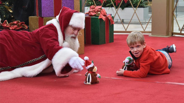 a1958ea932 Mall Santa lies on the floor to connect with autistic child
