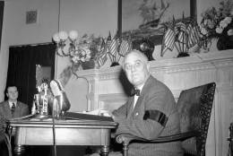 Presiden Franklin Roosevelt  speaking from in front of a fireplace in the oval room of the White House in Washington on Dec. 9, 1941 broadcast to the nation a declaration that ?we are now in this war, we are all in it ? all the way.? (AP Photo)
