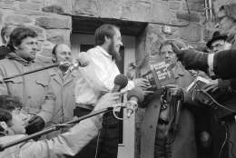 "Expelled Soviet author and Nobel Prize winner Alexander Solzhenitsyn grabs for the book ""The Gulag Archipelago"" in Langenbroich on Feb. 14, 1974 when journalists and onlookers asked him to sign his book, which he had in hand in this Western country for the first time. (AP Photo/Pro)"