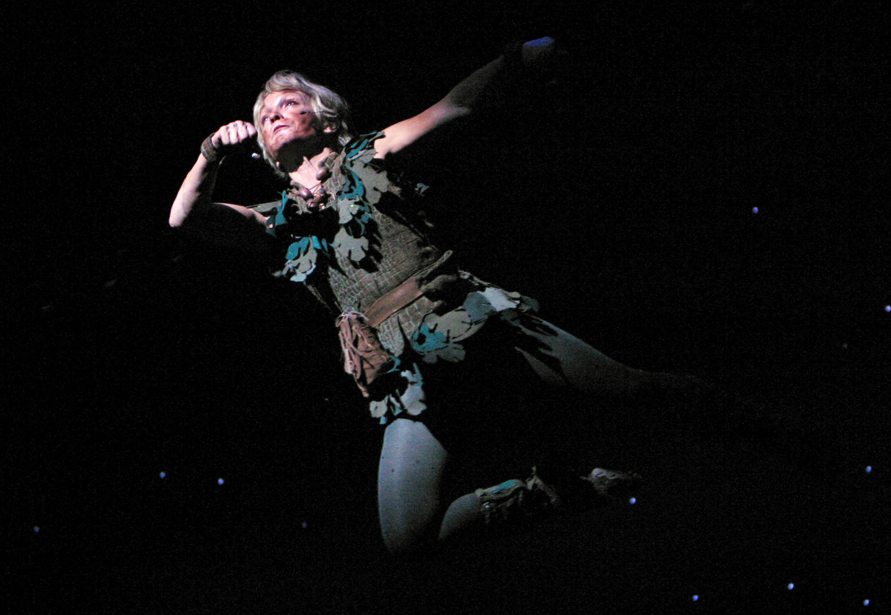 """Former Olympic gymnast and Broadway star Cathy Rigby, who is launching a nationwide, yearlong tour, performs as """"Peter Pan"""" at La Mirada Theater for the Performing Arts in La Mirada, Calif. Sept. 24, 2004. Rigby,  51, says this will be the last time she plays the role.  (AP Photo/Stefano Paltera)"""
