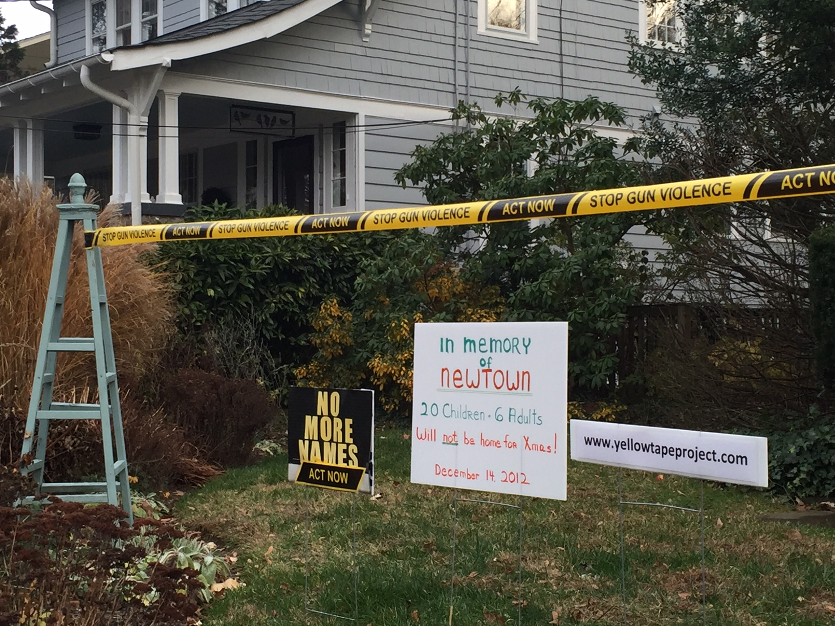 Yellow tape wraps D.C. neighborhood in call for change to gun laws