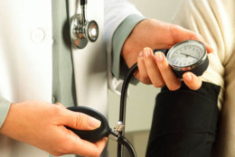 Taking blood pressure of patient