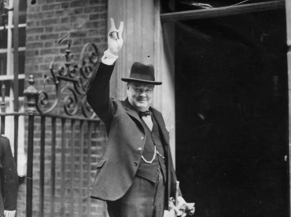 Prime Minister Winston Churchill outside 10 Downing Street, gesturing his famous 'V for Victory' hand signal, June 1943.  (Photo by H F Davis/Getty Images)