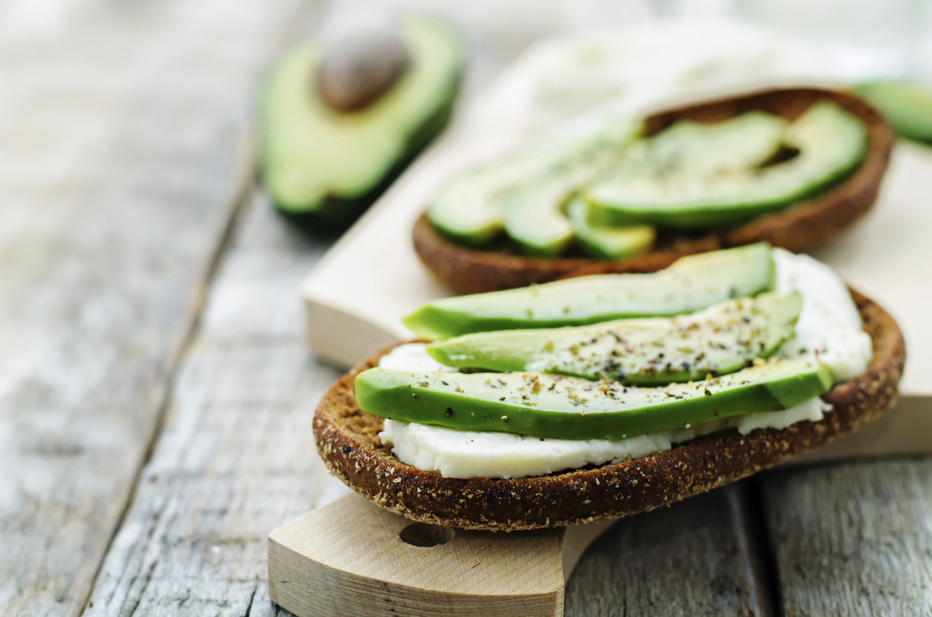 sandwich of rye bread with avocado and goat cheese