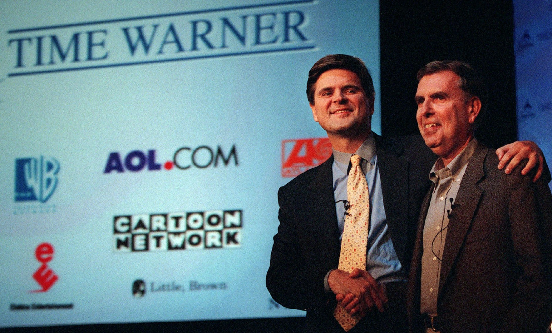 America Online's chairman and chief executive, Steve Case, left, and Time Warner's chairman and chief executive, Gerald Levin, shake hands before a news conference Monday, Jan. 10, 2000, in New York. Time Warner, the world's largest media and entertainment company, is being acquired by America Online for about $166 billion in stock in what would be the biggest corporate merger ever. (AP Photo/Stuart Ramson)