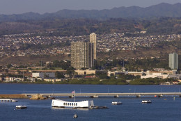 In this Monday, Jan. 25,  2010 photo, the Arizona Memorial marks the location where the USS Arizona's final resting place is in Naval Station Pearl Harbor in Honolulu. The Japanese attack happened Dec. 7, 1941. The USS Arizona is the final resting place for 1177 crew members who lost their lives in the attack. Hickam Air Force Base which is located next to Naval Station Pearl Harbor will be merged together as a way to streamline cost for both military installations. (AP Photo/Eugene Tanner)