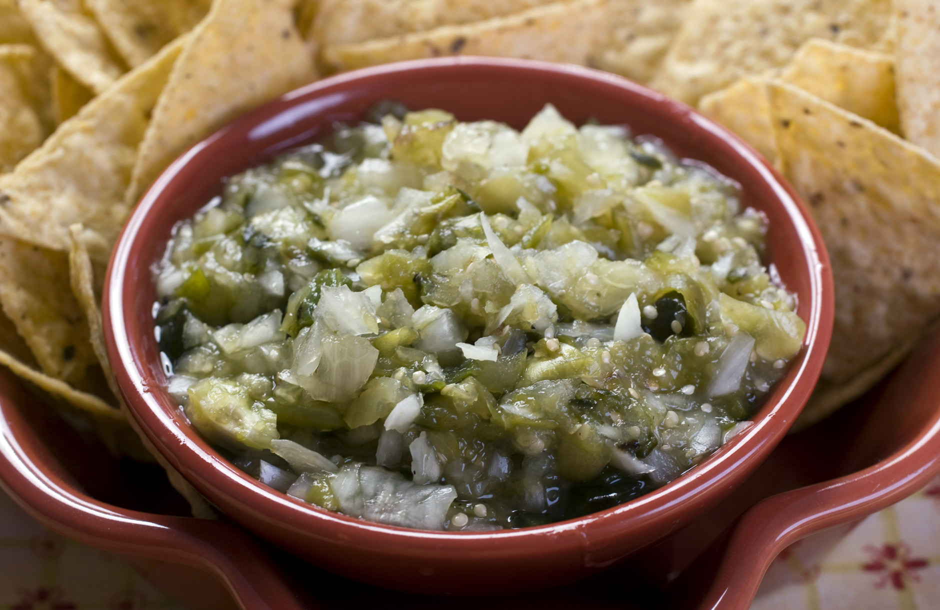 This Aug. 30, 2010 photo shows tomatillo, poblano and sweet onion salsa. Tomatillos are an often overlooked veggie that have traits similar to tomatoes and can be used raw or cooked. Grab some the next time you are at the market and try them in this salsa recipe.   (AP Photo/Larry Crowe)