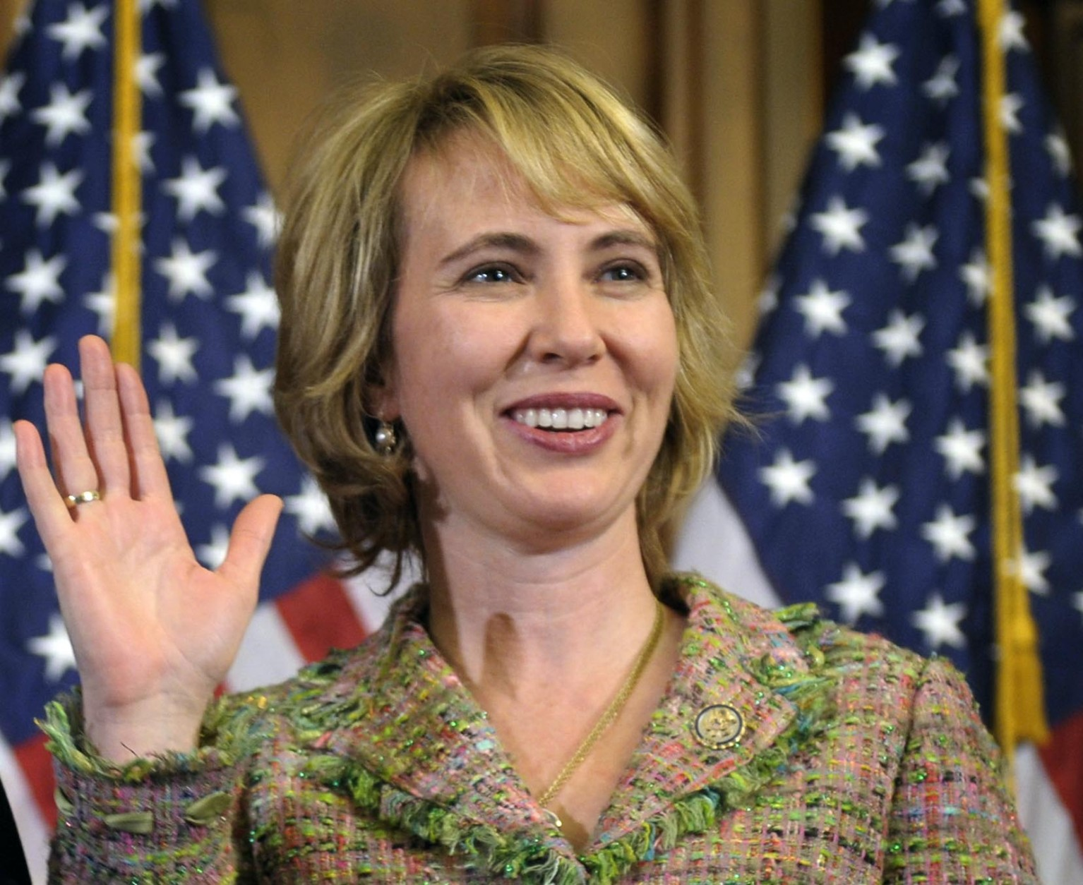 FILE - In this Jan. 5, 2011 file photo, Rep. Gabrielle Giffords, D-Ariz., takes part in a reenactment of her swearing-in, on Capitol Hill in Washington. Time magazine has named Giffords one of the 100 most influential people in the world. (AP Photo/Susan Walsh, File)