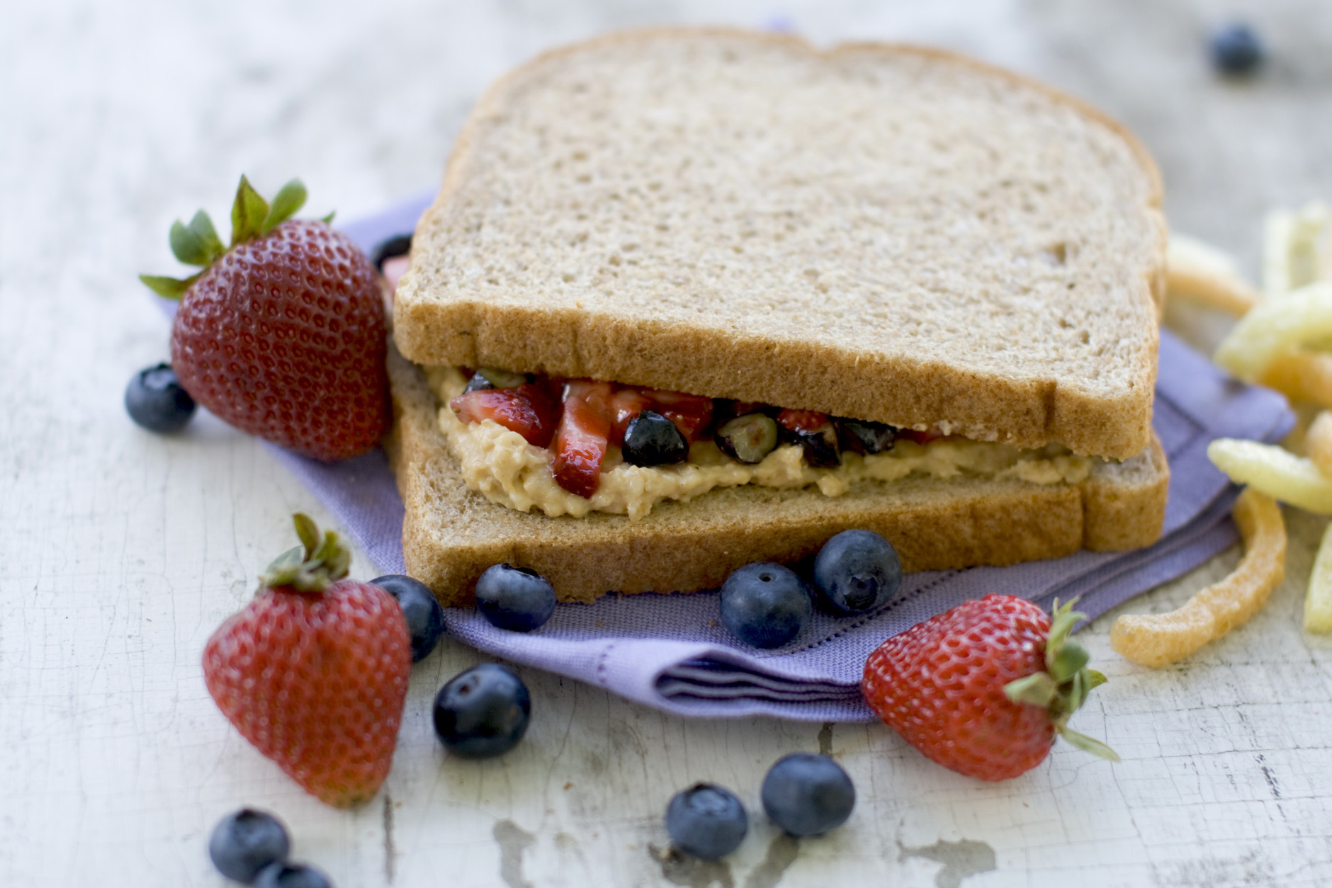 In this image taken on July 9, 2012, a healthy remake of a PB&J sandwich with fresh berries is shown in Concord, N.H. (AP Photo/Matthew Mead)