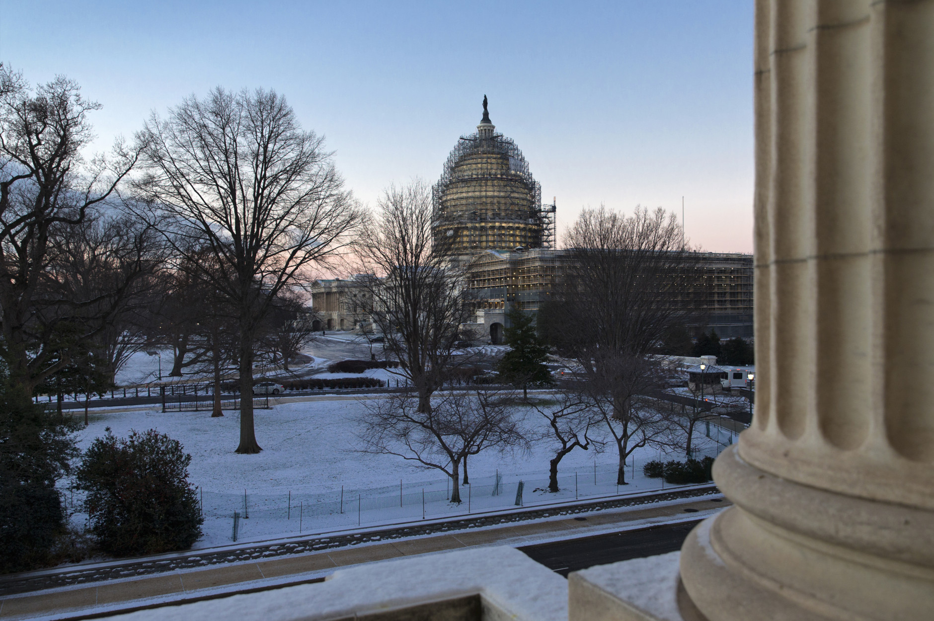 The Capitol in Washington, Thursday morning, Jan. 21, 2016, after less than an inch of overnight snow created hazardous road conditions and major traffic delays. The Washington region could get up to two feet of snow along with strong winds and whiteout conditions on Friday night and Saturday. (AP Photo/J. Scott Applewhite)