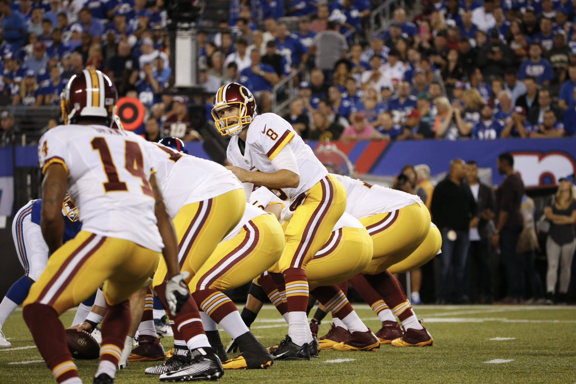 Washington Redskins quarterback Kirk Cousins (8) looks over his offensive line during the first half an NFL football game against the New York Giants Thursday Sept. 24, 2015, in East Rutherford, N.J. (AP Photo/Kathy Willens)