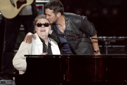 Luke Bryan, right, kisses Ronnie Milsap as they perform at ACM Presents Superstar Duets at Globe Life Park on Friday, April 17, 2015, in Arlington, Texas. (Photo by Chris Pizzello/Invision/AP)