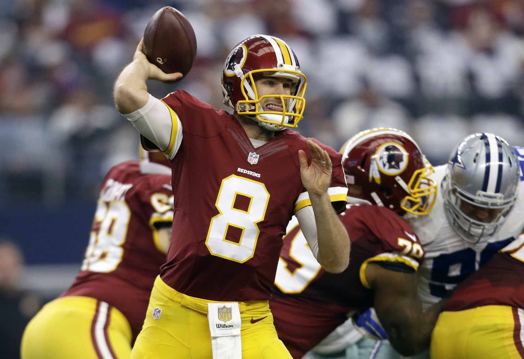Washington Redskins quarterback Kirk Cousins (8) looks to pass under pressure in the first half of an NFL football game against the Dallas Cowboys on Sunday, Jan. 3, 2016, in Arlington , Texas. (AP Photo/Tim Sharp)