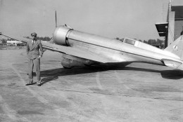 """Millionaire sportsman, movie producer and holder of flight speed records Howard Hughes, poses by his air speedster shortly before roaring westward to Los Angeles, from Chicago, Ill., May 14, 1936, in an effort set a """"lunch-to-dinner"""" air record. Inspired by a $50 bet, he had lunch in Chicago, then was off in an effort to reach Los Angeles in time for dinner. (AP Photo)"""