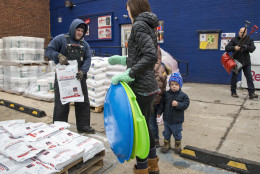 Residents of the Capitol Hill neighborhood in Washington flock to Frager's Hardware, Friday, Jan. 22, 2016, to prepare for the anticipated blizzard that's heading for the Eastern U.S. and threatening the District of Columbia with two feet of snow.  (AP Photo/J. Scott Applewhite)