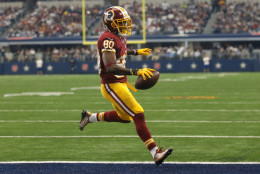 Washington Redskins wide receiver Jamison Crowder enters the end zone for a touchdown after catching a pass in the first half of an NFL football game against the Dallas Cowboys on Sunday, Jan. 3, 2016, in Arlington, Texas. (AP Photo/Michael Ainsworth)
