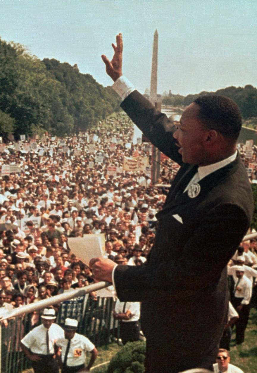 """Dr. Martin Luther King Jr. acknowledges the crowd at the Lincoln Memorial for his """"I Have a Dream"""" speech during the March on Washington, D.C. Aug. 28, 1963.  Thursday April 4, 1996 will mark the 28th anniversary of his assassination in Memphis, Tenn. The Washington Monument is in background. (AP Photo/File)"""