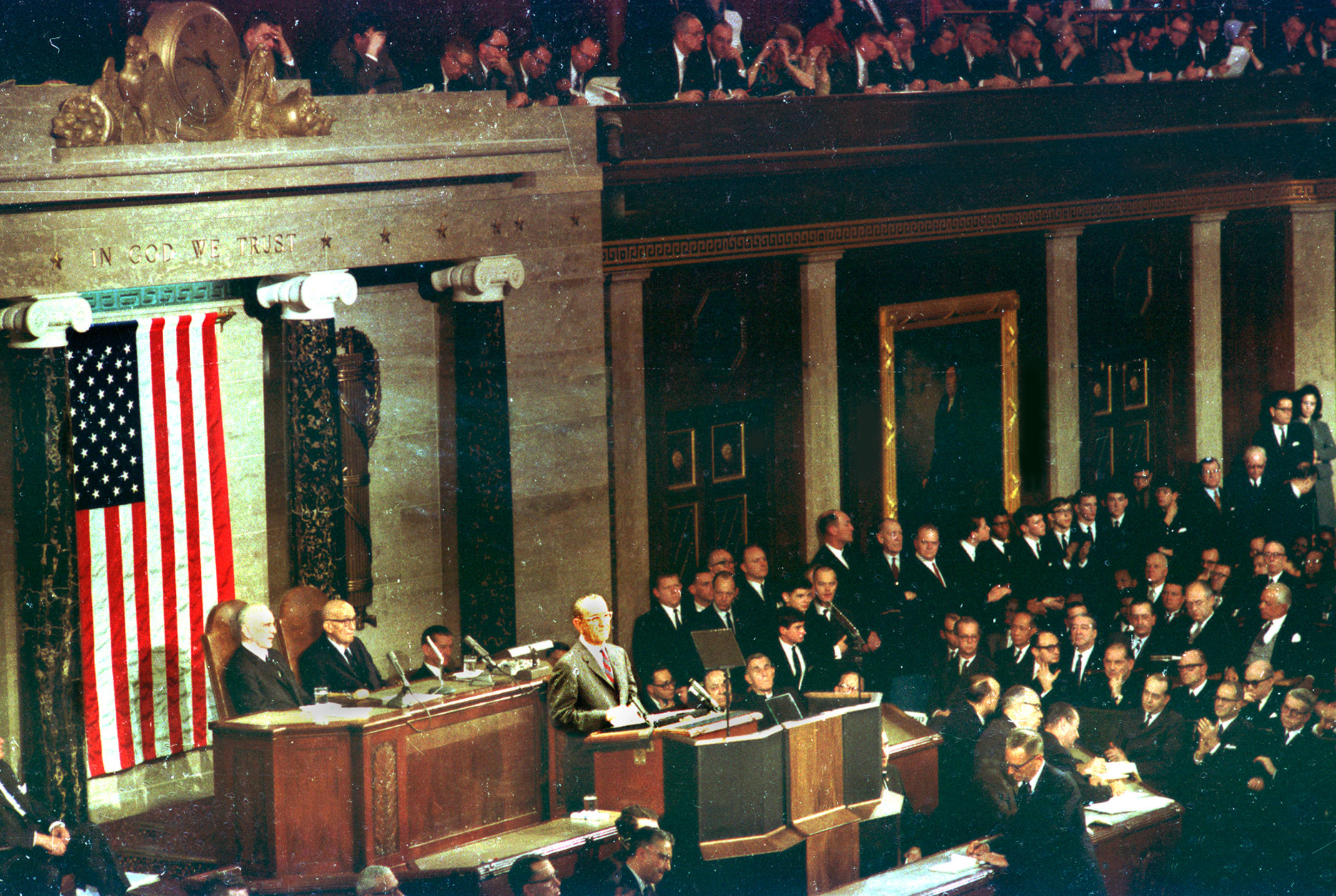 U.S. President Lyndon B. Johnson delivers the State of the Union address before the joint session of Congress in the House of Representatives in Washington D.C. on Jan. 12, 1966.  Seated behind the President are house speaker John McCormack, seated left, and Arizona Senator Carl Hayden (Dem).  (AP Photo)