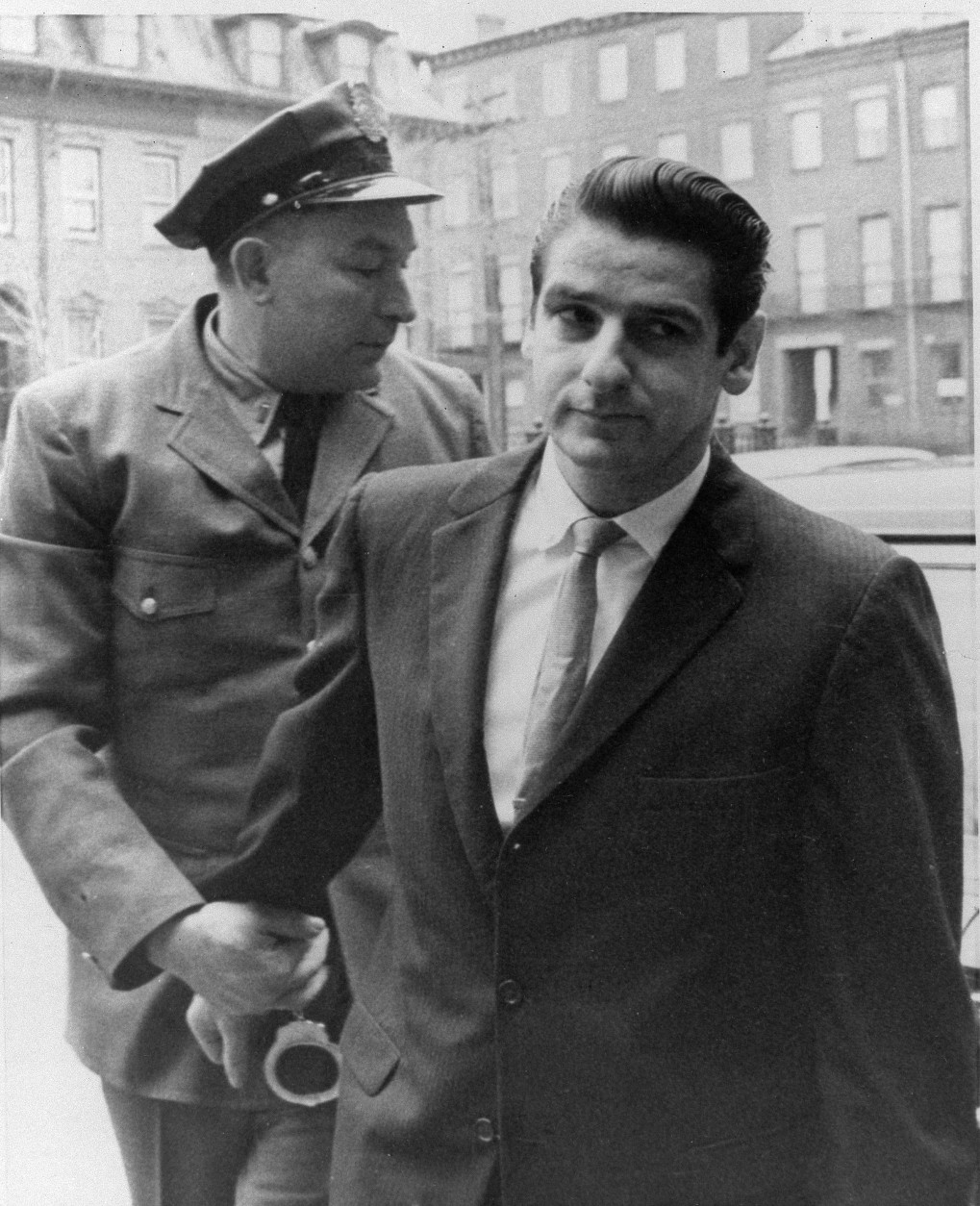 Albert DeSalvo, 34-year-old mental patient who says he is the Boston Strangler, arrives at court in Cambridge, Mass., Jan. 10, 1967, in police custody for trial on a variety of charges not related to the stranglings.  (AP Photo)