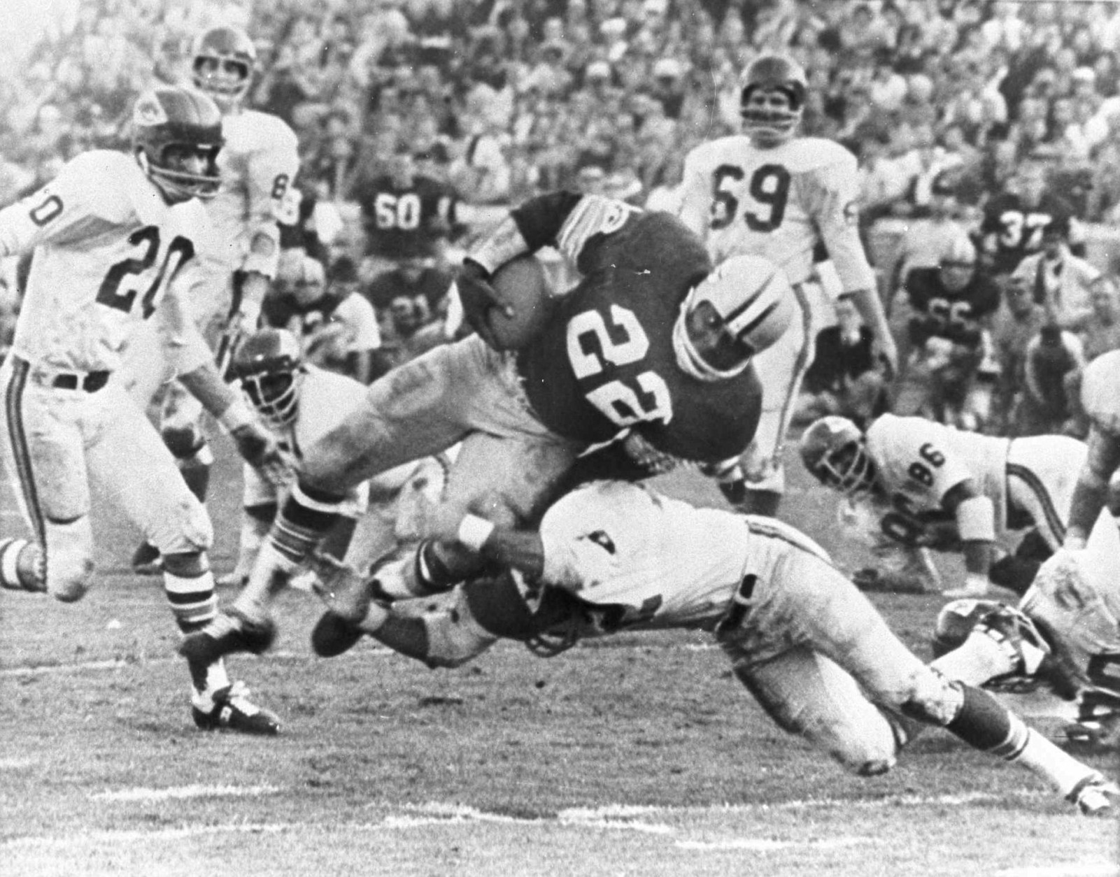 The Packers' Klijah Pitts (22) goes over right tackle to the Chiefs' five-yard line, a six-yard gain, before being brought down by Kansas City's Johnny Robinson in the fourth quarter of the Super Bowl game in Los Angeles Jan. 15, 1967.  Three plays later Pitts went over for the touchdown as the Packers beat the Chiefs 35 to 10.  Others include Bobby Hunt (20) and Sherrill Headrick (69).  (AP Photo)