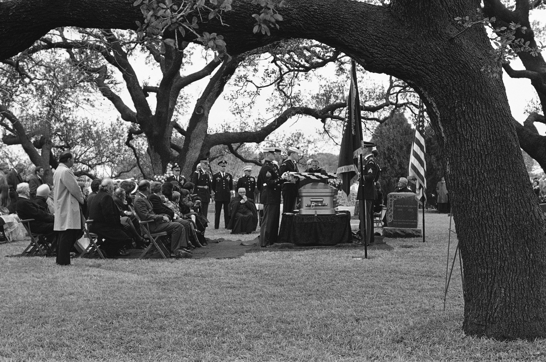Rev. Billy Graham delivers the eulogy at the funeral of former President Lyndon B. Johnson at the family cemetery on the LBJ ranch in Stonewall, Texas on Jan. 25, 1973. The family is seated at the left with Mrs. Lady Bird Johnson sitting in the center of the group. (AP Photo)