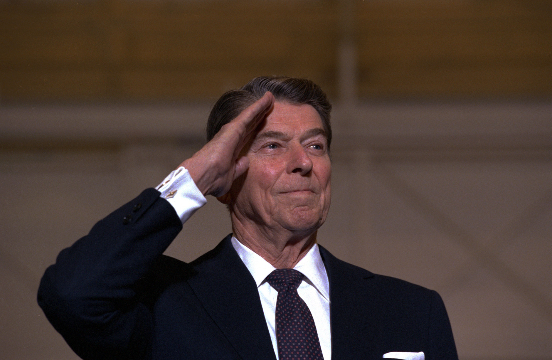 Former U.S. President Ronald Reagan is shown saluting in 1989.  (AP Photo)
